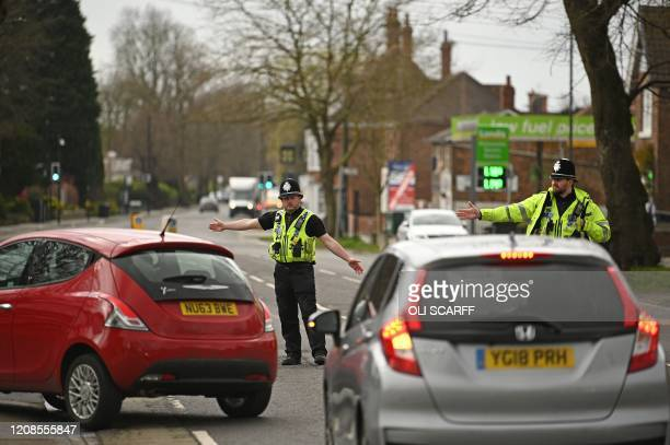 Police officers from North Yorkshire Police stop motorists in cars to check that their travel is essential in line with the British Government's...