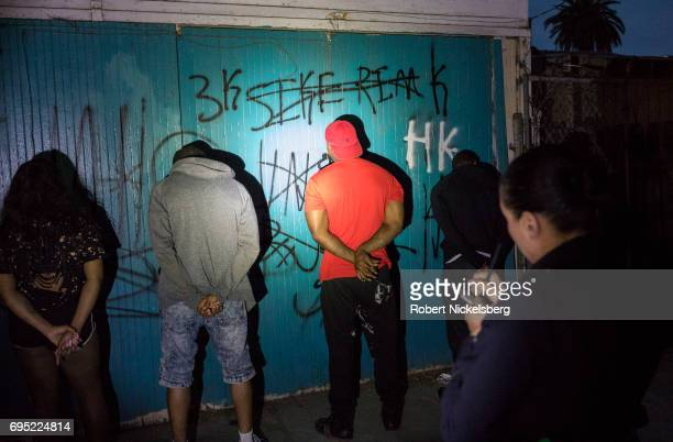 Police officers from the 77th Division gang unit detain several Crip gang members May 21 2017 for a violation of smoking marijuana in public in Los...