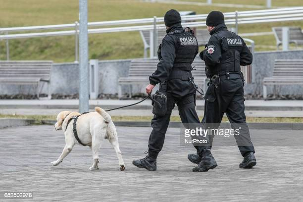 Police officers from the antibomb pyrotechnic special police unit with Labrador Retriever type dog are seen on 12 March 2017 in Gdynia Poland The...