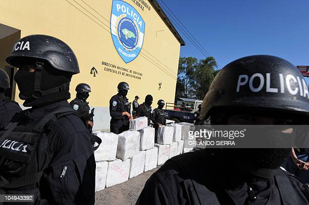 Police officers from the antidrug squad in Tegucigalpa on October 7 2010 look after a load of 500 kilos of cocaine seized from traffickers during a...