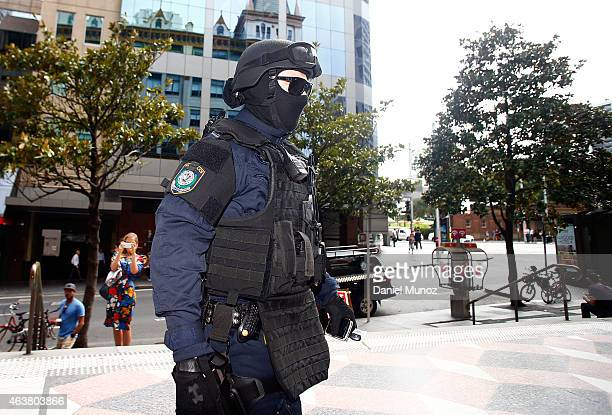 Police officers from the antiriots squad patrol the Downing Centre local courts on February 19 2015 in Sydney Australia Court officials are refusing...