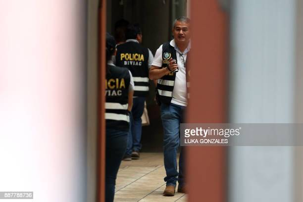 Police officers from the High Complexity Investigations Division and prosecutor's office members search into one of Keiko Fujimori's Fuerza Popular...