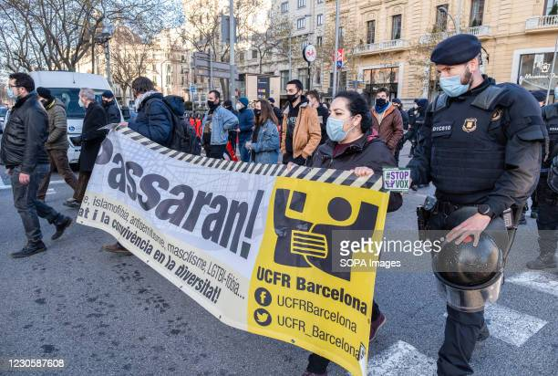 Police officers from the Mossos d'Esquadra of Catalonia are seen moving anti-fascist militants to a new rally point away from the information tent of...