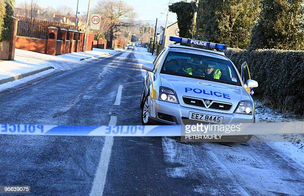 Police officers from the Police Service of Northern Ireland maintain a cordon around Milltown Road in Randalstown Northern Ireland on January 8 after...