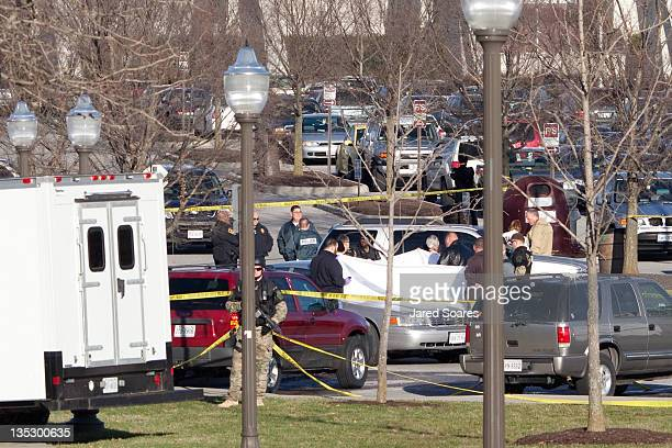Police officers gather around the scene of a shooting in front of Cassell Coliseum on the Virginia Tech campus December 8 2011 in Blacksburg Virginia...