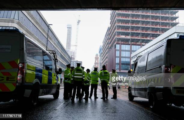 Police officers gather as protesters take part in a large scale demonstration against austerity and the Conservative government on September 29 2019...