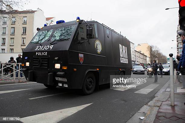 Police officers gather at the site of a shooting on the morning of January 8 2015 in Montrouge district of Paris France A policewoman and a city...