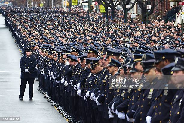 Police officers gather for the funeral of New York Police Department Officer Wenjian Liu at Aievoli Funeral Home on Sunday Jan 4 2015 in Brooklyn NY...