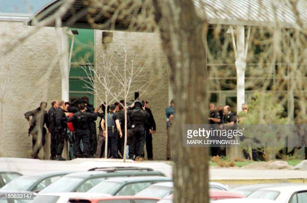 Police officers gather in front of Columbine High School in Littleton CO before searching the building to insure that it was secure 20 April 1999...