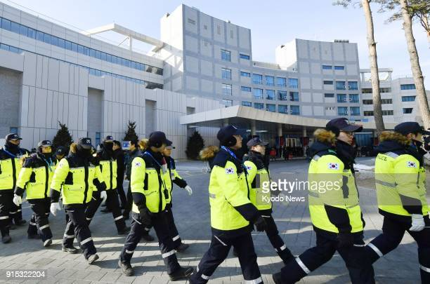 Police officers gather near a hotel in Inje South Korea on Feb 7 where members of North Korean cheerleading and taekwondo demonstration squads are...