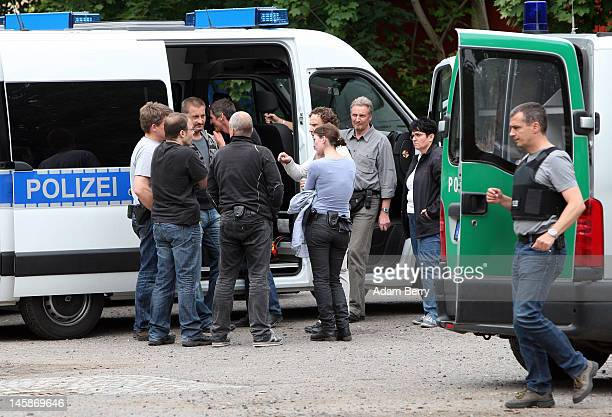 Police officers gather outside of the clubhouse of the motorcycle gang Bandidos Del Este on June 7 2012 in Hennigsdorf just outside of Berlin Germany...