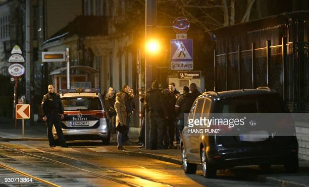 Police officers gather outside the Iranian ambassador's residence in Vienna on early on March 12 2018 where a 26yearold Austrian was shot dead after...