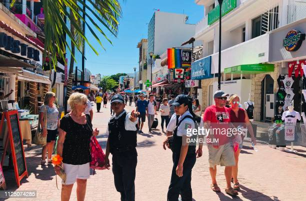Police officers give instructions to a tourist on the Fifth Avenue in the beach in the seaside tourist resort of Playa del Carmen Quintana Roo State...