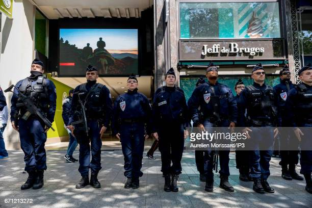Police officers give tribute to the Police Officer killed in the shooting last night on the Champs Elysees avenue on April 21 2017 in Paris France A...