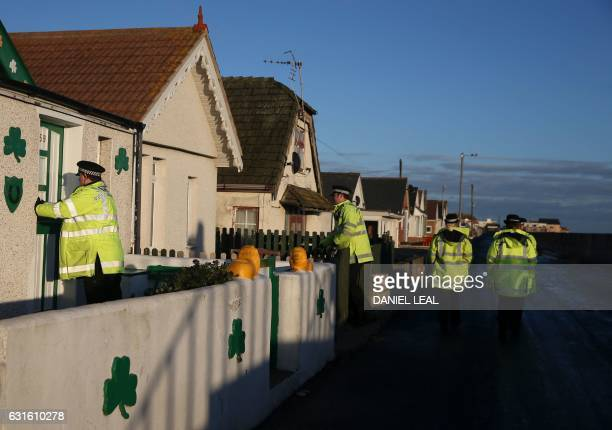 Police officers go door to door giving information on flood risks to residents in Jaywick southeast England on January 13 2017 Seaside residents in...