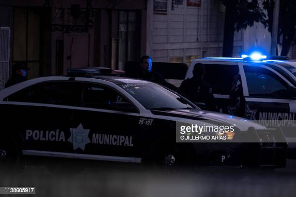 Police officers guard a crime scene where a man was killed by gun fire in downtown Tijuana Baja California state Mexico on April 21 2019 Violence in...