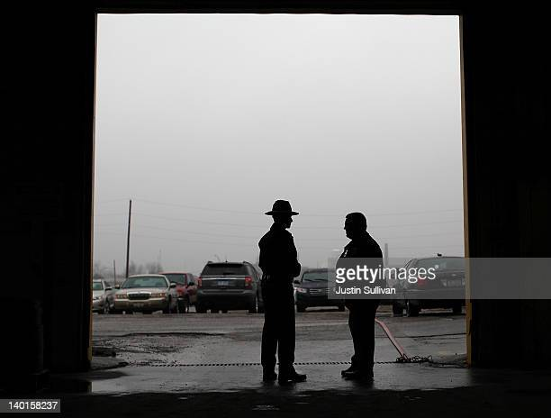 Police officers guard a door as Republican presidential candidate, former Massachusetts Gov. Mitt Romney tours a manufacturing facility following a...