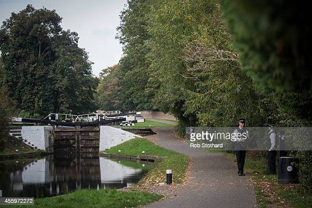 Police officers guard a path leading to the bank of the River Brent in the area where police are searching for missing schoolgirl Alice Gross on...