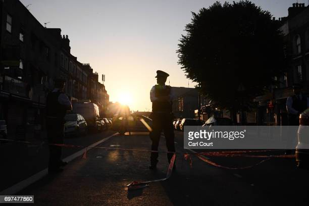 Police officers guard a road leading to an incident in which a van hit worshippers near Finsbury Park Mosque on June 19 2017 in London England...