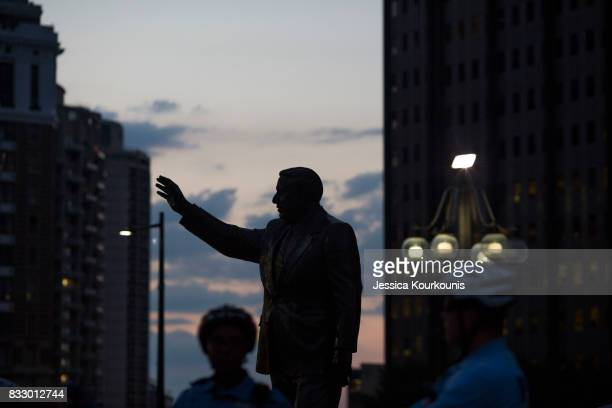 Police officers guard a statue of former Philadelphia mayor Frank Rizzo as protesters march against white supremacy August 16 2017 in downtown...