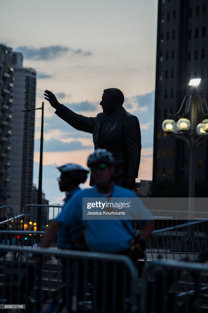 Police officers guard a statue of former Philadelphia mayor Frank Rizzo as protesters march against white supremacy August 16, 2017 in downtown Philadelphia, Pennsylvania. Detractors call the statue a symbol of white supremacy and want it taken down. Demonstrations are being held following clashes between white supremacists and counter-protestors in Charlottesville, Virginia over the weekend.