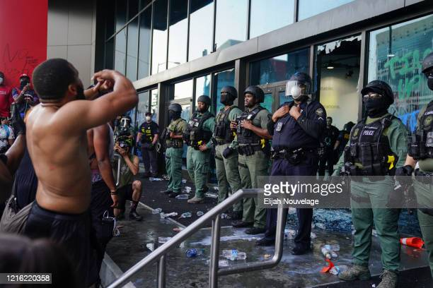 Police officers guard CNN Center during a protest on May 29 2020 in Atlanta Georgia Demonstrations are being held across the US after George Floyd...