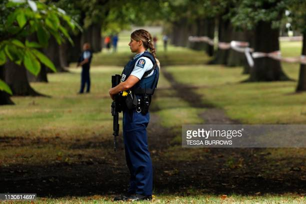 Police officers guard the area close to the Masjid al Noor mosque after a shooting incident in Christchurch on March 15 2019 Attacks on two...