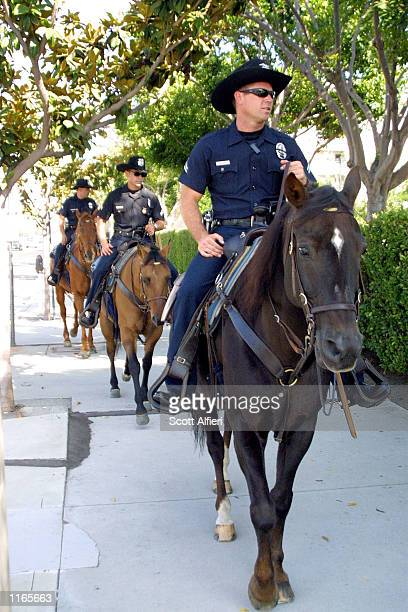 Police officers guard the CBS studios as celebrities arrive for 'America A Tribute To Heroes' telethon September 21 2001 in Los Angeles CA...