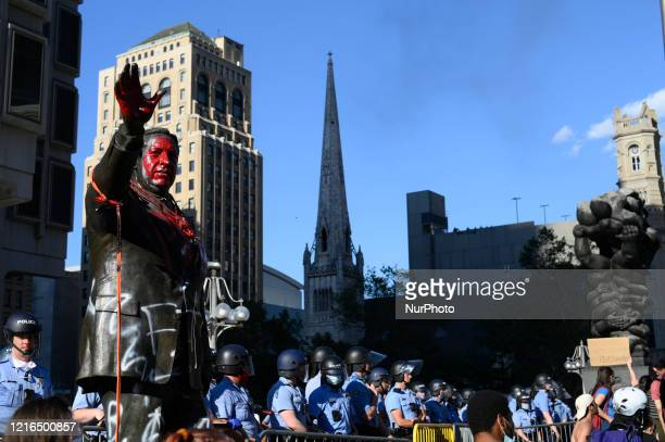 Police officers guard the controversial Frank Rizzo statue as protestors clash with police near City Hall in Philadelphia PA on May 30 2020 Cities...