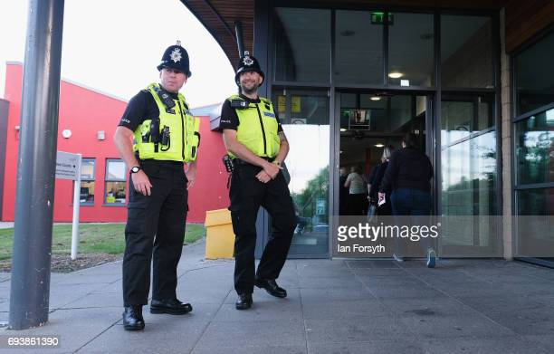 Police officers guard the entrance at Silksworth Community Pool Tennis and Wellness Centre where votes will be counted on June 8 2017 in Sunderland...