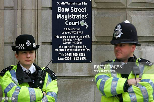 Police officers guard the entrance to Bow Street magistrates court in London 21 March 2005 Moutaz Almallah Dabas was arrested in Slough Berkshire...