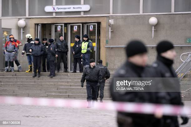 Police officers guard the entrance to Sennaya Square metro station in Saint Petersburg on April 3 2017 Russia's Investigative Committee said Monday...