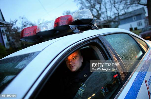 Police officers guard the house of Daniel Pantaleo in Staten Island NY on December 05 2014 Pantaleo is the officer who put Eric Garner in an apparent...