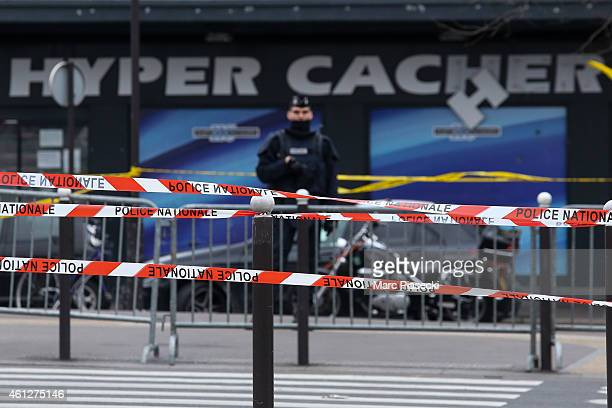 Police officers guard the kosher market 'Hyper Cacher' which suffered a terrorist attack yesterday on January 10 2015 in Paris France Four hostages...