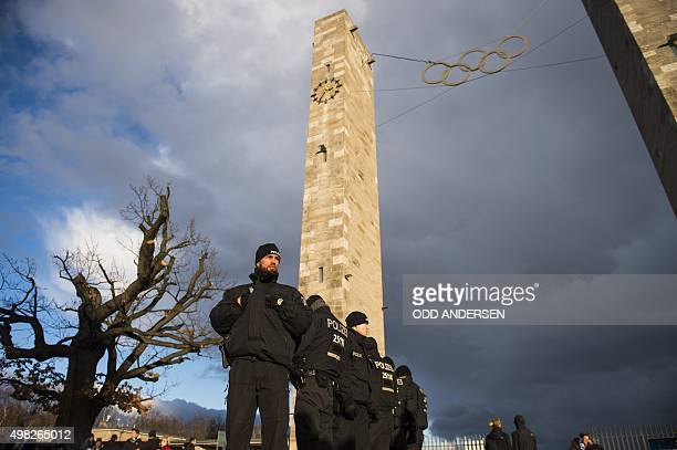 Police officers guard the main entrance to the Olympic Stadium prior to the German first division Bundesliga football match Hertha BSC Berlin vs TSG...