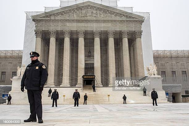 Police officers guard the plaza in front of the US Supreme Court as antiabortion protesters hold the March for Life on January 25 2013 in Washington...