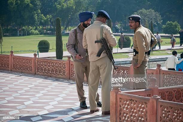 Police officers guarding the Taj Mahal in Agra, India