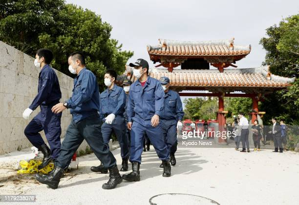Police officers head to inspect Shuri Castle at a World Heritage site in Naha Okinawa Prefecture southern Japan on Nov 1 to find out the cause of a...