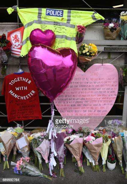A police officer's hivis jacket adorned with messages of support is pictured alongside flowers and balloons Victoria Station car park near to the...