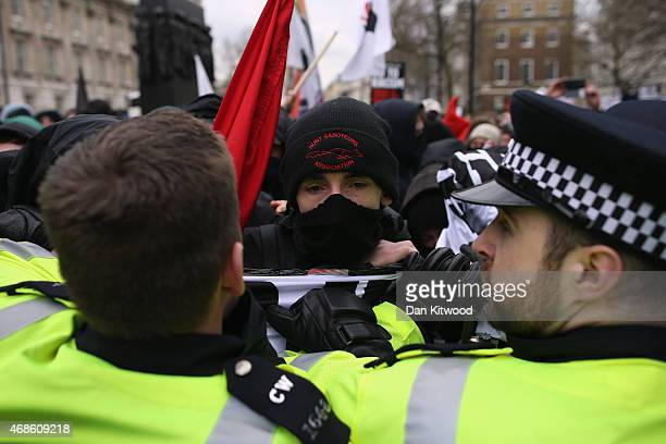 Police officers hold anti fascist protesters back as a Pegida Rally takes place on Whitehall on April 4 2015 in London England The British offshoot...