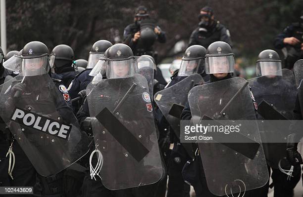 Police officers hold back demonstrators protesting the G8/G20 summits on June 26, 2010 in Toronto, Ontario Canada. Store windows were smashed and a...