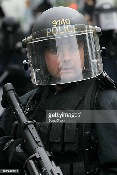 Police officers hold back demonstrators protesting the G8/G20 summits June 26, 2010 in Toronto, Ontario Canada. Store windows were smashed and a...