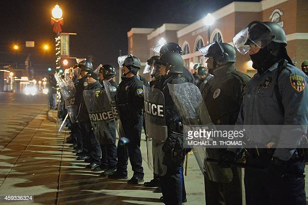 Police officers hold position during a protest on November 20 2014 outside the Ferguson Police Department in Ferguson Missouri The governor of the US...