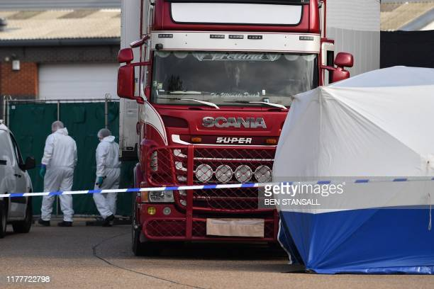 Police officers in a forsensic suits are photographed at the scene with a lorry believed to have originated from Bulgaria and found to be containing...