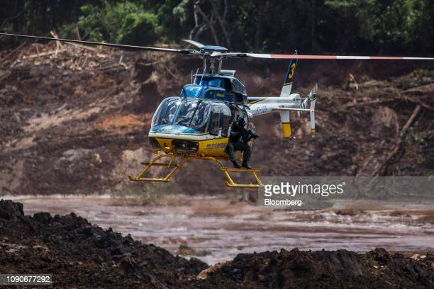Police officers in a helicopter shoot animals trapped in the mud after a Vale SA dam burst in Brumadinho, Minas Gerais state, Brazil, on Monday, Jan....