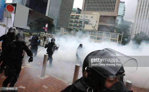 Police officers in antiriot gear retaliating to the antiextradition bill protestors near the Legislative Council Complex on June 12 2019 in Tamar...