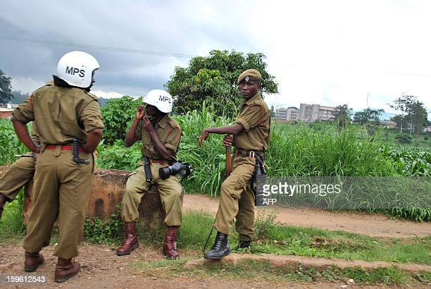 Police officers in combat gear sot near the flea market in Blantyre on January 17 2013 Around a thousand people marched under heavy police guard to...