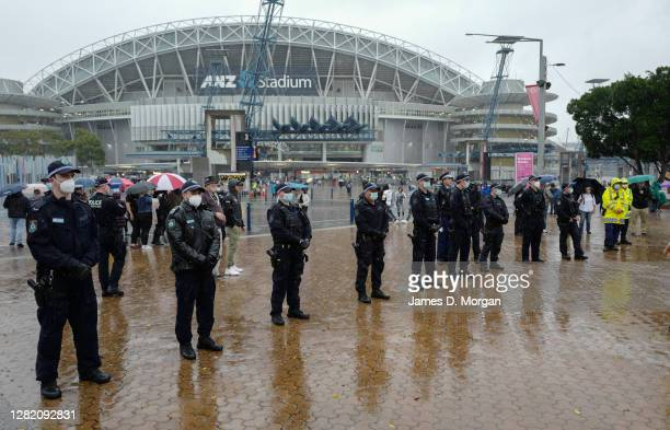 Police officers in facemasks line up to prevent an attempt by anti-lockdown protestors to gather outside ANZ Stadium on October 25, 2020 in Sydney,...