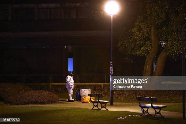 Police officers in forensics suits and protective masks work at the scene of the poisoning of Sergei Skripal on March 13 2018 in Salisbury England...