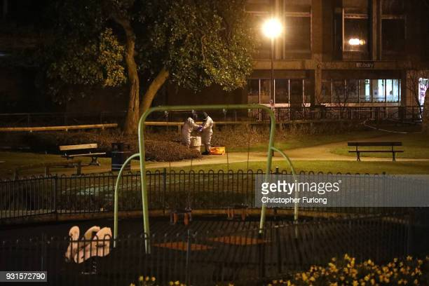 Police officers in forensics suits and protective masks work next to a children's park at the scene of the poisoning of Sergei Skripal on March 13...